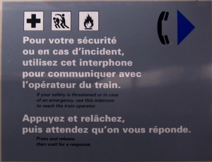 A sign on the Métro with a weird icon in the middle
